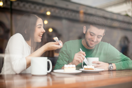 coffee time: Good looking young couple laughing and having a good time on a date in a coffee shop
