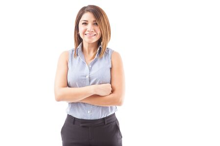executive women: Portrait of a beautiful female teacher smiling with her arms crossed on a white background Stock Photo