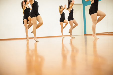 routing: Closeup of a group of female dancers practicing a dance routing together in a studio Stock Photo