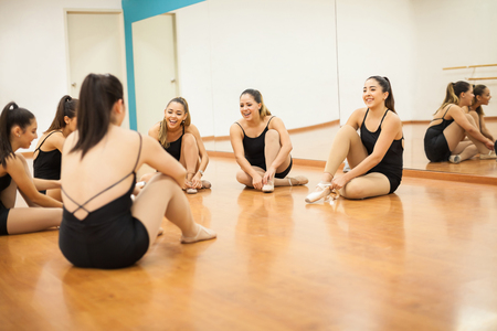 'getting ready': Group of female dancers getting ready for their dance practice and having some fun together