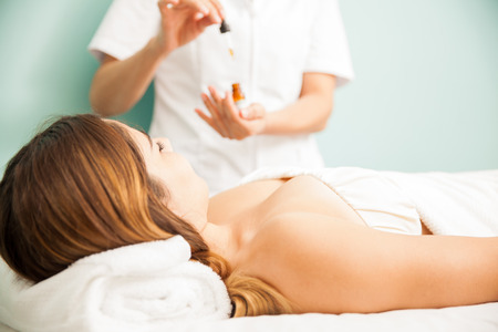 spa therapy: Young brunette getting some bach flower therapy at a health and beauty clinic and spa