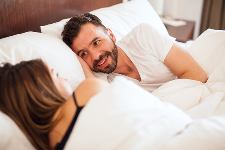 Handsome young Hispanic man with a beard sleeping with his girlfriend and enjoying her company