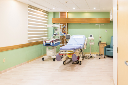 maternity ward: Wide view of an empty hospital bed in the maternity ward at a hospital