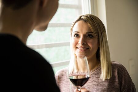 boyfriend: Portrait of a beautiful young Latin woman enjoying a glass of wine with her boyfriend at home