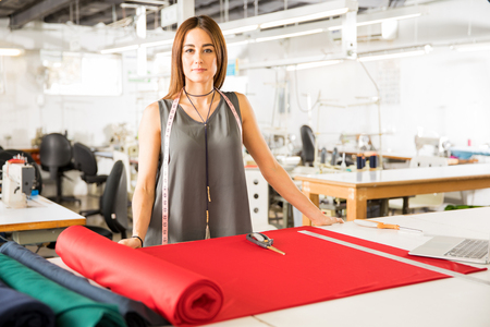 Portrait of a young and confident fashion designer doing some creative work in a textile factory