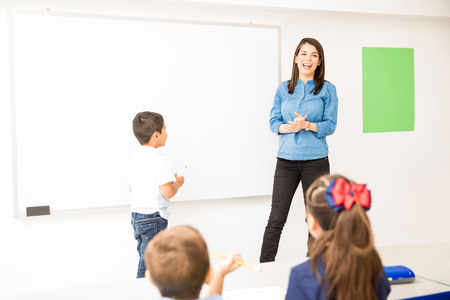 Little boy ready to draw on the board while playing a game in a preschool classroom Stock Photo - 91940844