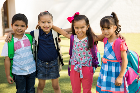 Portrait of a group of friends hanging out outdoors while going to preschool together