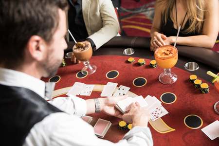 Point of view of a card dealer at work in a blackjack table in a casino Stockfoto