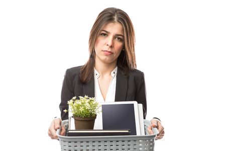 Portrait of a sad looking businesswoman with her personal belongings just got fired