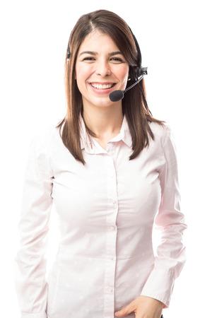 Portrait of a beautiful young Hispanic woman working as a tech support representative in a call center Foto de archivo