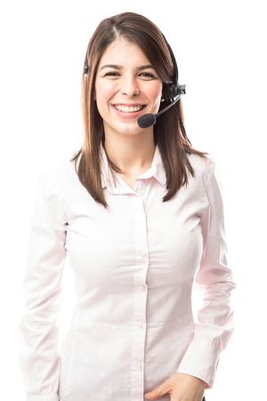 Portrait of a beautiful young Hispanic woman working as a tech support representative in a call center Archivio Fotografico
