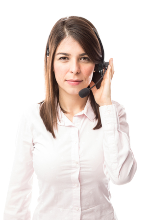 Pretty young Latin woman working as a customer service representative in a call center