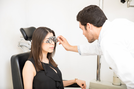 Beautiful woman patient to check vision in ophthalmological clinic