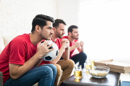 Devoted supporters watching every move of team on television at home
