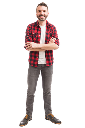 Full length of fashionable man showing contentment on white background