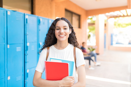 Smiling female student enhancing her future by attending regular lectures
