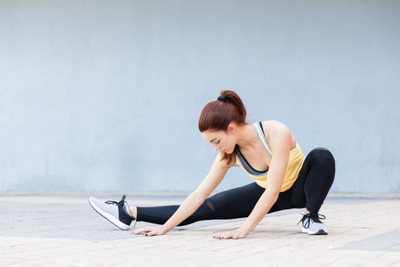 Full length of young woman in sportswear enjoying her exercise routine