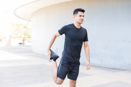 Active man stretching during workout to keep his lifestyle healthy Reklamní fotografie