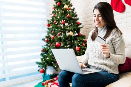 Happy woman got her last moment gift online on laptop at home during Christmas