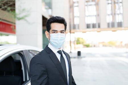 Portrait of young businessman wearing face mask during coronavirus outbreak 版權商用圖片