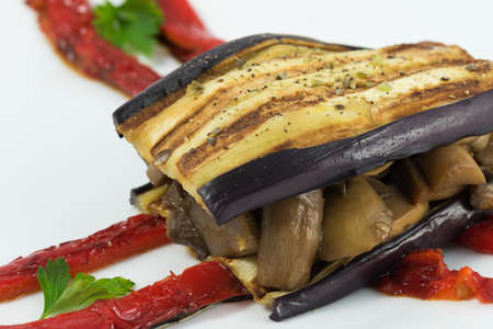 Delicious plate of eggplant, sandwich style, in its interior highlights a portion of mushrooms, zucchini, peppers and aubergine.
