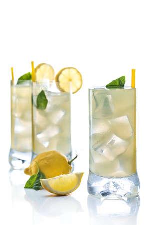 Cold lemonade accompanied with lemons and good grass