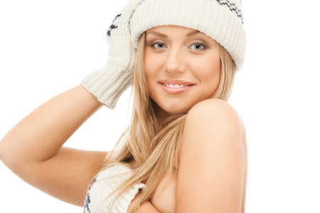 Young blond woman in knit mittens and cap photo