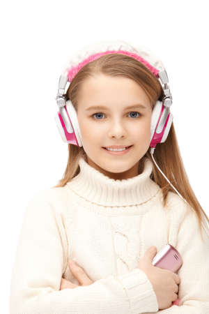 young attractive girl in headphones listening music photo