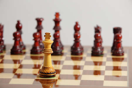 Chess king alone in danger challenging in front of its opponent