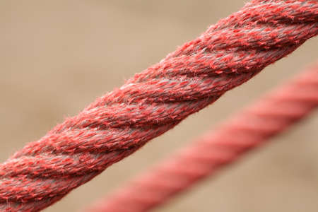 steadiness: Tight red ropes  Unfocused background
