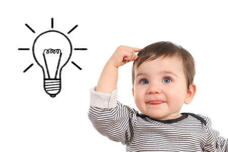 Baby thinking an idea with a bulb in a white isolated background photo