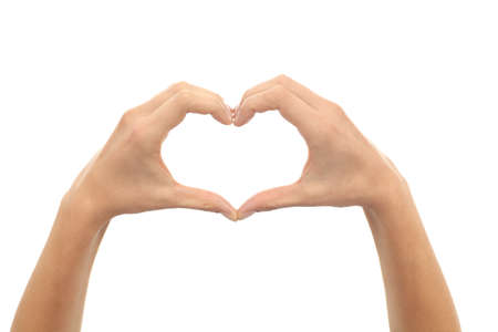 Woman hands making a heart shape on a white isolated background              Stock Photo