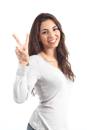 victory sign: Young beautiful woman making victory sign on a white isolated background