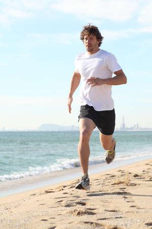 adult footprint: Man running in the beach  Diagonal view Stock Photo