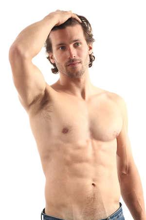 abdominal fitness: hombre sexy sobre un fondo blanco aislado