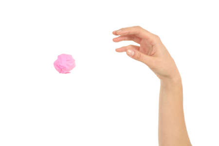 throw paper: Woman hand throwing a paper on a white isolated background