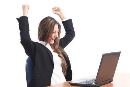 Euphoric business woman watching a laptop on a white isolated background Stock Photo - 17384799