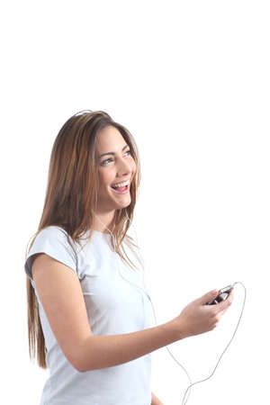 Woman singing and  listening to the music with headphones on a white isolated background                  photo