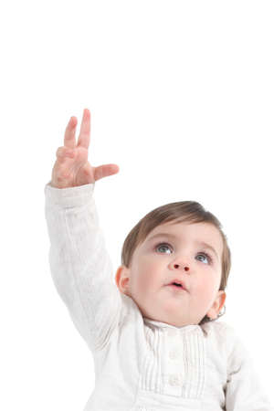 reach: Baby trying to reach something up on a white isolated background                  Stock Photo