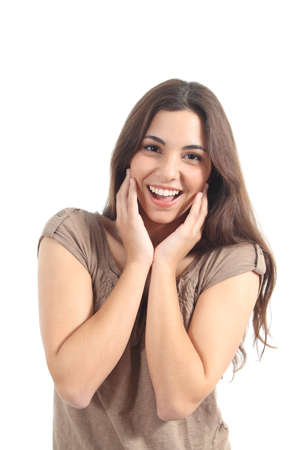 euphoric: Euphoric woman expression with her hands on the face on a white isolated background              Stock Photo