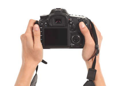 photo shooting: Beautiful woman hands holding a dslr camera in a white isolated background