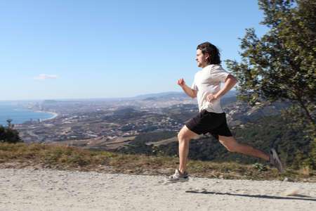 Man running on a path with Barcelona city in the background photo