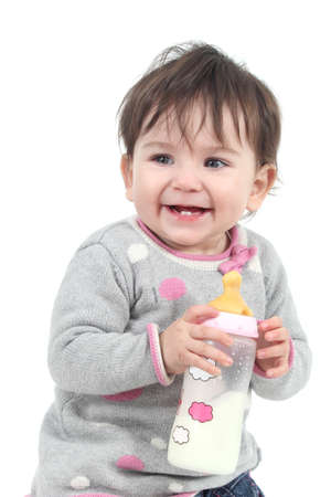 Happiness baby holding a feeding bottle on a white isolated background photo