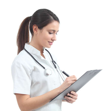 medical notes: Beautiful nurse smiling and taking notes on a white isolated background                  Stock Photo