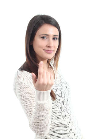 Beautiful woman making a beckoning gesture on a white isolated background