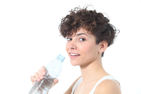 Beautiful woman smiling with a bottle of fresh water on a white isolated background Stock Photo - 17886843