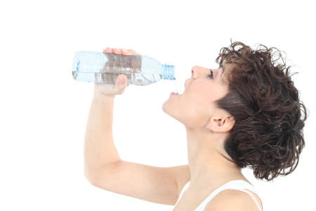 Woman drinking water from a plastic bottle on a white isolated background Stock Photo - 17886853