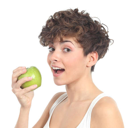 Beautiful woman ready to eat an apple on a white isolated background Stock Photo - 17886844