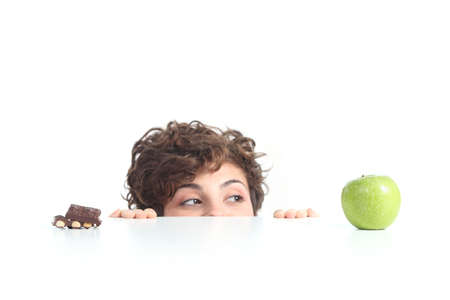 Beautiful woman choosing the apple on a white isolated background photo