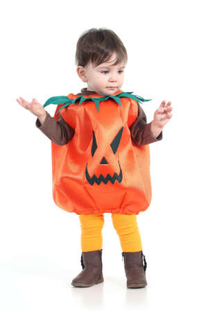 Baby with a halloween pumpkin disguise  on a white isolated background         Stock Photo - 17996484